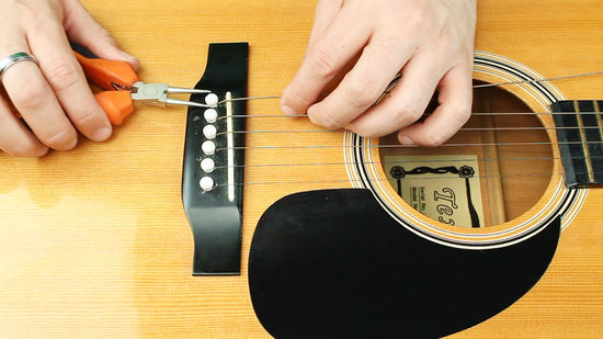 RESTRING AN ACOUSTIC GUITAR